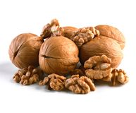 Walnuts, whole and cores closeup isolated on white background. This image has better resolution and quality, and absolute sharpness from foreground to stock photos