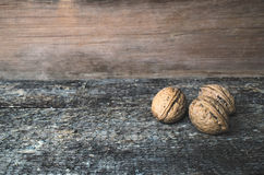 Walnuts. Whole walnuts on a wooden rustic background Royalty Free Stock Image