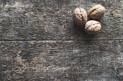 Walnuts. Whole walnuts on a wooden rustic background, top view Royalty Free Stock Image