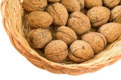 Walnuts & wicker basket Stock Photos