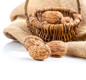 Walnuts in a wicker basket Royalty Free Stock Photography