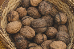 Walnuts on a wicker basket Stock Photo