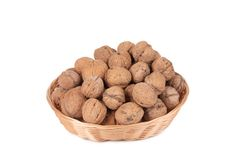 Walnuts in a wicker basket Royalty Free Stock Images