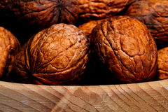 Walnuts in a wicker basket on white background closeup. Walnuts in a wicker basket on a white background closeup Royalty Free Stock Photos
