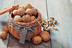 Walnuts in wicker basket Stock Images