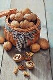 Walnuts in wicker basket Royalty Free Stock Photo