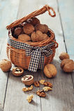 Walnuts in wicker basket Royalty Free Stock Photography