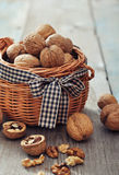 Walnuts in wicker basket Royalty Free Stock Images