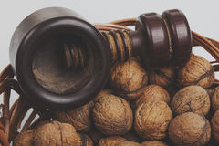 Walnuts in a willow basket with nutcracker Stock Photo