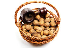 Walnuts in a willow basket with nutcracker Stock Photos
