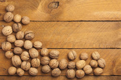 Walnuts on wood Stock Images