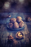 Walnuts. On wood aces rustic table background Stock Photos