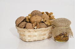 Walnuts in wood basket and nuts jam. In small jar Stock Photography