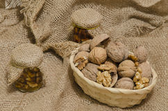 Walnuts in wood basket and nuts jam Stock Images