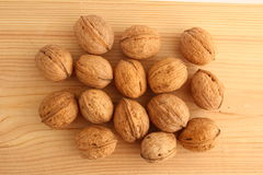 Walnuts on Wood Stock Photography