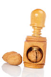 Walnuts and wood nutcracker. Some walnuts and wood nutcracker reflected on white background Stock Photography