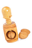 Walnuts and wood nutcracker. Some walnuts and wood nutcracker reflected on white background Royalty Free Stock Photos