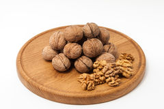 Walnuts on wood plate Stock Photography