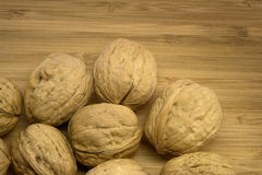 Walnuts on Wood. Some Walnuts Closeup on Wood Royalty Free Stock Photos