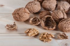 Walnuts. On a wood table royalty free stock images