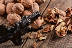 Walnuts on wood table Stock Image