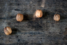 Walnuts on wooden background closeup Stock Photography