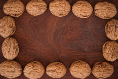 Walnuts on wooden background. Frame of walnuts on wooden background Royalty Free Stock Photography