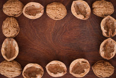 Walnuts on wooden background. Frame of walnuts on wooden background Stock Photo