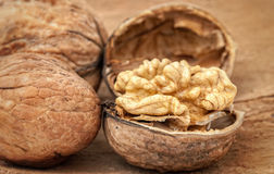 Walnuts on  wooden background Stock Photo