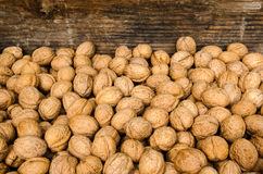 Walnuts on wooden background Stock Image