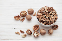 Walnuts on  wooden background Stock Photos