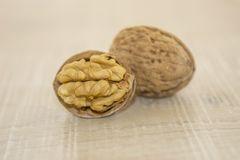 Walnuts on a wooden base Royalty Free Stock Photo