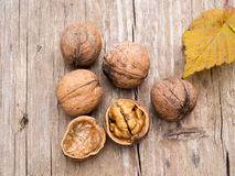 Walnuts. On a wooden board Stock Photos
