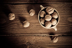 Walnuts on wooden boards. Stock Photography