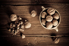 Walnuts on wooden boards. Royalty Free Stock Images