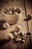Walnuts on wooden boards. Royalty Free Stock Photo