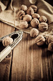 Walnuts on wooden boards. Stock Photo