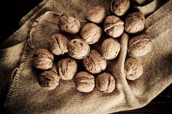 Walnuts on wooden boards. Royalty Free Stock Photos