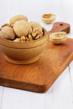 Walnuts in a wooden bowl Royalty Free Stock Photo