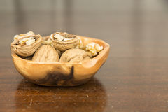 Walnuts in a Wooden Bowl Royalty Free Stock Images