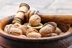 Walnuts in a wooden bowl Stock Photo