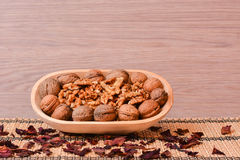 Walnuts on wooden bowl Royalty Free Stock Images