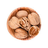 Walnuts in wooden bowl Royalty Free Stock Images