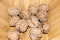 Walnuts in a wooden bowl. Stock Photo