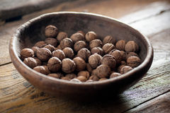 Walnuts in  wooden bowl Royalty Free Stock Photo