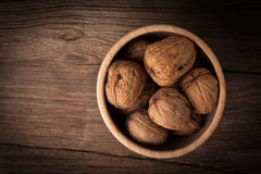 Walnuts in wooden bowl. Stock Photography