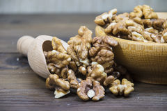 Walnuts in wooden bowl. Small pieces of Walnuts in wooden bowl Stock Image