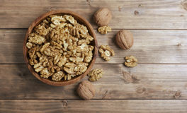 Walnuts in wooden bowl Royalty Free Stock Image