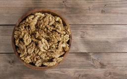 Walnuts in wooden bowl Royalty Free Stock Photos