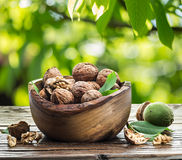 Walnuts in the wooden bowl. Royalty Free Stock Photos